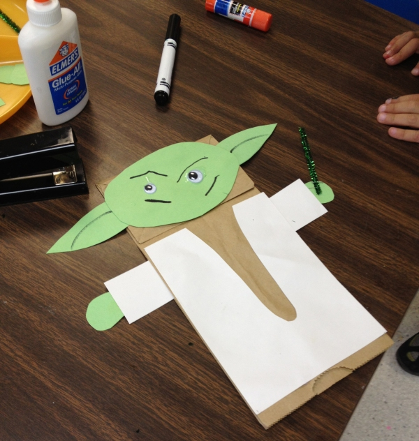 Cutting materials for Yoda hand puppets is time consuming.